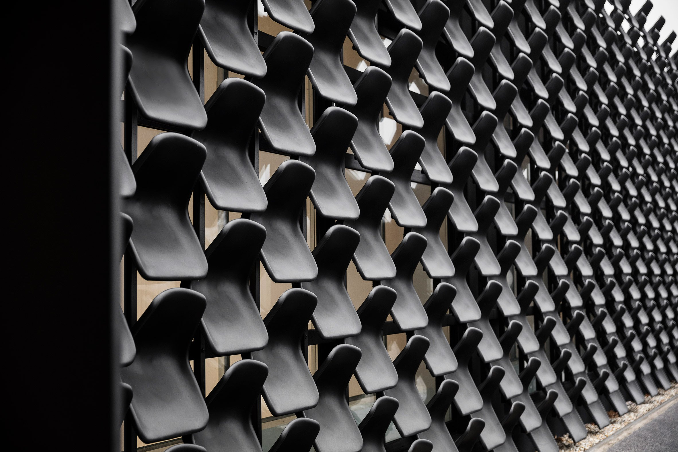 Chybik + Kristof uses 900 plastic chairs to clad Czech furniture showroom