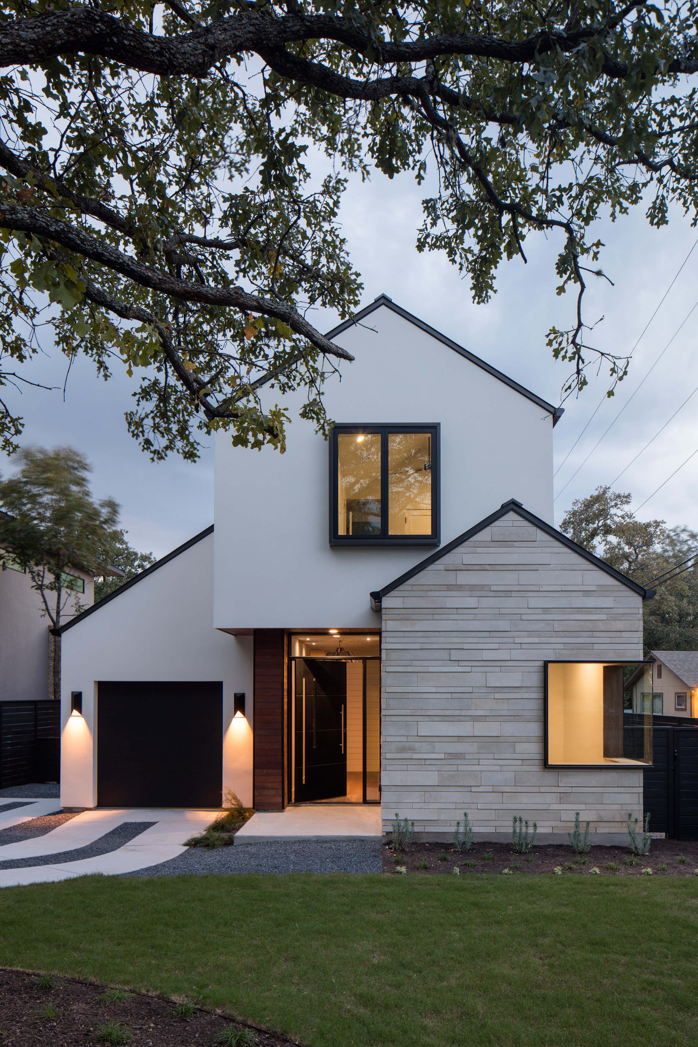 Gabled home in Austin by Dick Clark + Associates references surrounding properties